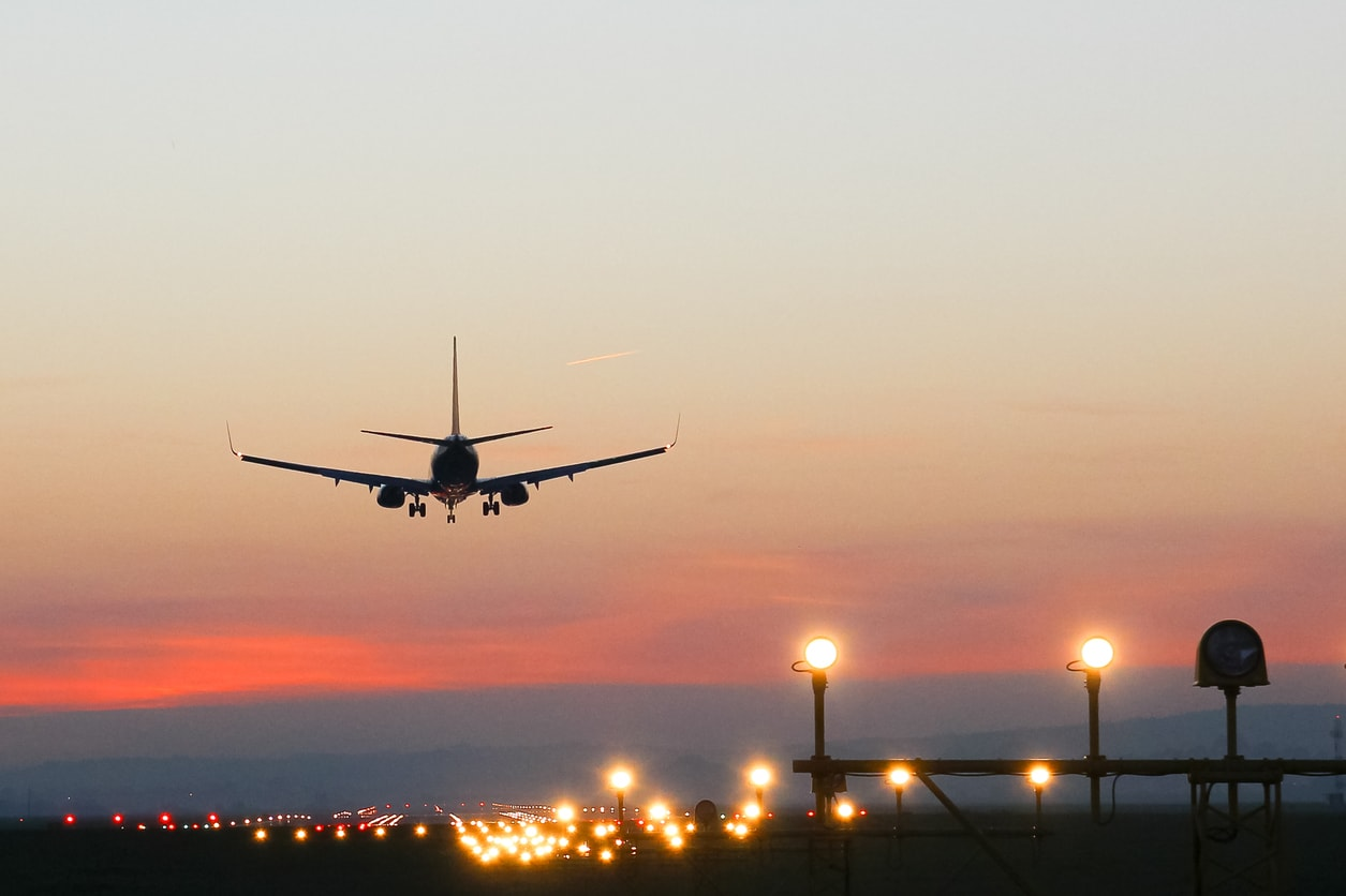 plane-landing : a plane landing at sunset